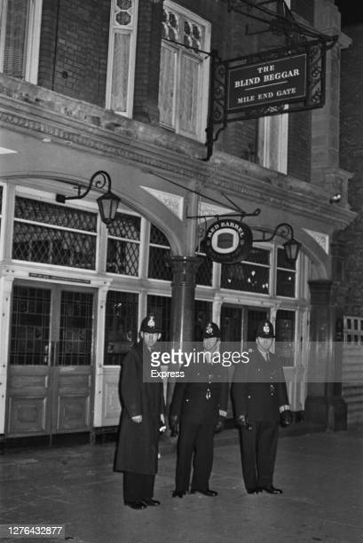 Police officers stand guard outside the Blind Beggar pub on Whitechapel Road in Mile End London after the murder of George Cornell by gangster Ronnie...