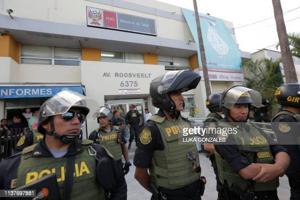 Police officers stand guard outside the Casimiro Ulloa Emergency Hospital in Lima where Peruvian expresident Alan Garcia is undergoing emergency...