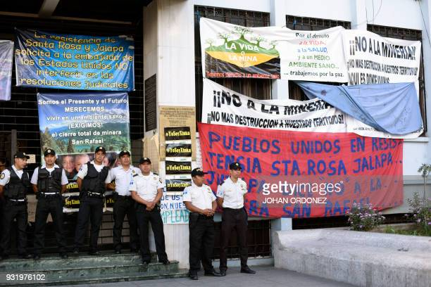 Police officers stand guard outside the Guatemalan constitutional court as workers of the silver mining company San Rafael the Guatemalan branch of...