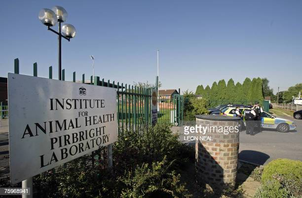Police officers stand guard outside the Institute for Animal Health Pirbright Laboratory currently the suspected source of the outbreak of the highly...