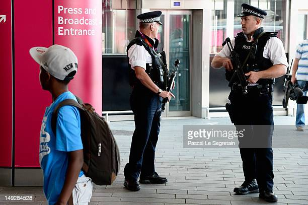 Police officers stand guard outside the Stratford Tube Station on July 26 2012 in London England