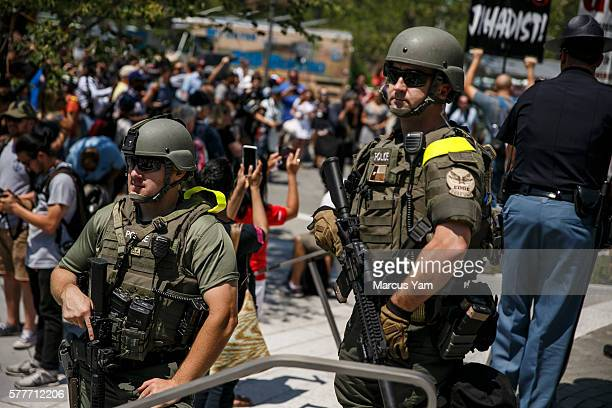 CLEVELAND OHIO TUESDAY JULY 19 2016 Police officers stand guard with assault rifles at the Public Square in downtown during the second day of the...