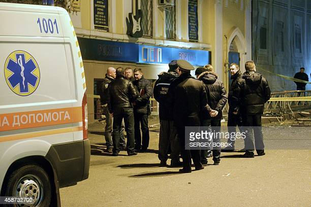 Police officers stand in a street after an explosion in a pub in the center of northeastern Ukrainian city of Kharkiv on November 10 2014 Eleven...