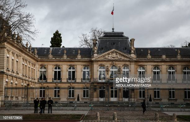 Police officers stand in a street during a 'Yellow Vests' demonstration on December 22 2018 in Versailles The 'Yellow Vests' movement in France...