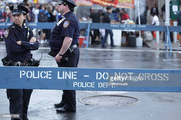 nypd police officers stand in brooklyn street - new york city police department stock pictures, royalty-free photos & images