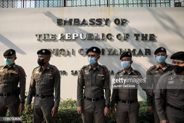Police officers stand in front of Myanmar's embassy during a protest on February 01, 2021 in Bangkok, Thailand. Myanmar's military Junta on Monday,...