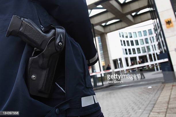 Police Officers stand in front of the Federal Prosecutor's office on December 1 2011 in Karlsruhe Germany Investigators have arrested three possible...