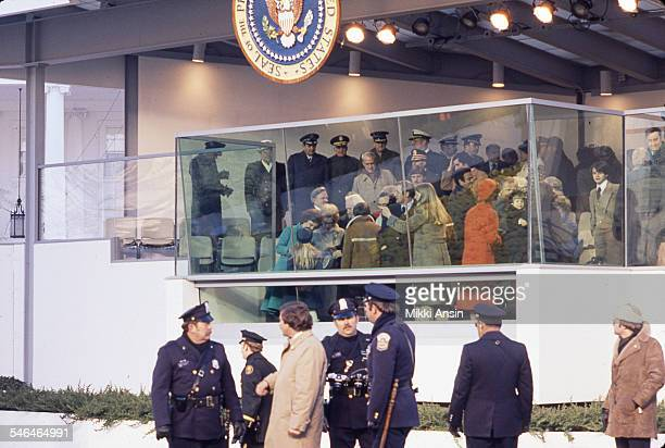 Police officers stand in front of the viewing stand for President Carter's Inaugural Parade Washington DC January 20 1977 Among those visible on the...