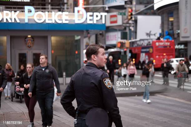 Police officers stand in midtown Manhattan on November 05 2019 in New York City Following a turbulent threeyear run as Police Commissioner James...