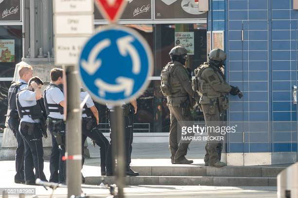 Police officers stand in position in the Central Station in Cologne western Germany on October 15 2018 German police on Octtober 15 2018 closed down...
