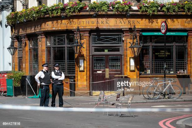 Police officers stand inside a cordon outside The Southwark Tavern by Borough Market following the June 3rd attacks on June 10 2017 in London England...