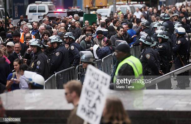 Police officers stand inside Zuccotti Park after police removed the Occupy Wall Street protesters from the park early in the morning on November 15,...