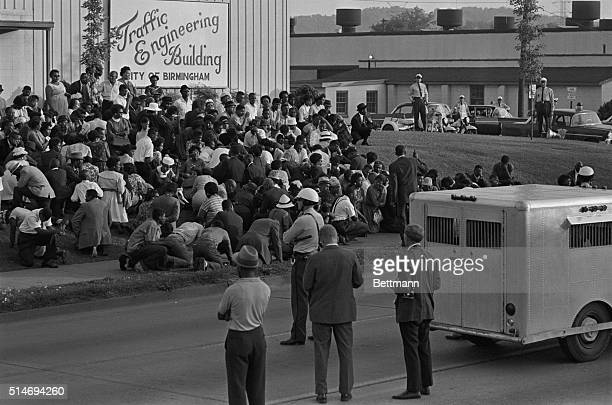 Police officers stand near a paddy wagon as African American protesters gather in front of the Traffic Engineering Building in Birmingham Alabama |...