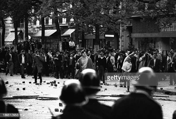 Police officers stand off againts a large group of brickthrowing demonstrators during a confrontation on the boulevard SaintGermain Paris France May...