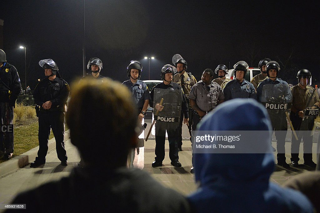 Protests errupt after Ferguson Mayor announces resignation of city Police Chief : News Photo