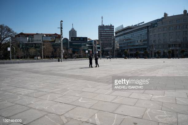 police officers stand on an empty Belgrade's main square on March 17 2020 Serbia's President said the new restrictions were necessary to save our...