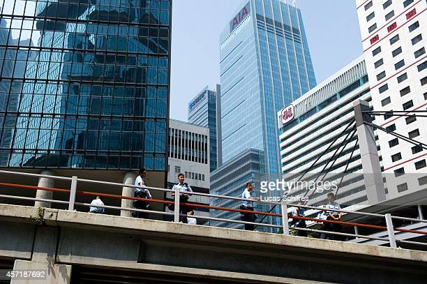 Police officers stand on Cotton Tree drive regained from 'Occupy Central' protesters in Admirality on October 14, 2014 in Hong Kong. In the morning...