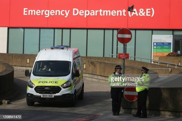 Police officers stand on duty outside St Thomas' Hospital in central London on April 9 where Britain's prime minister is in intensive care as he...