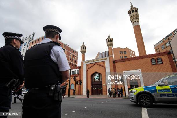 Police officers stand on patrol outside the East London Mosque on March 15 2019 in London England Patrols have been increased after 49 people were...