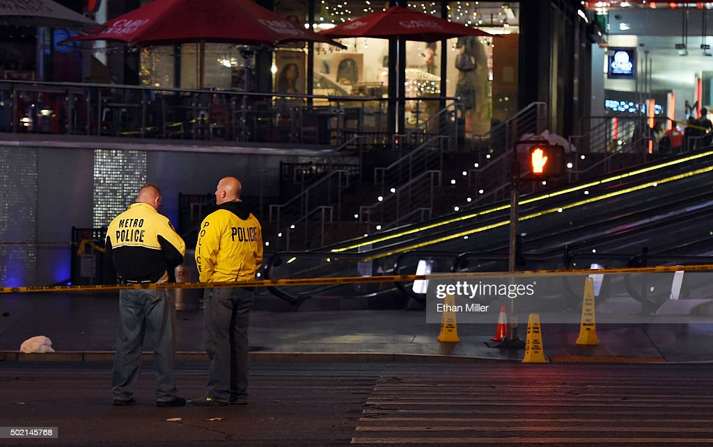 Police officers stand on the Las Vegas Strip which was closed to all vehicle traffic after a car crashed into a group of pedestrians on the sidewalk in front of the Paris Las Vegas and Planet Hollywood Resort & Casino reportedly injuring at least 35 people and killing one on December 20, 2015 in Las Vegas, Nevada.