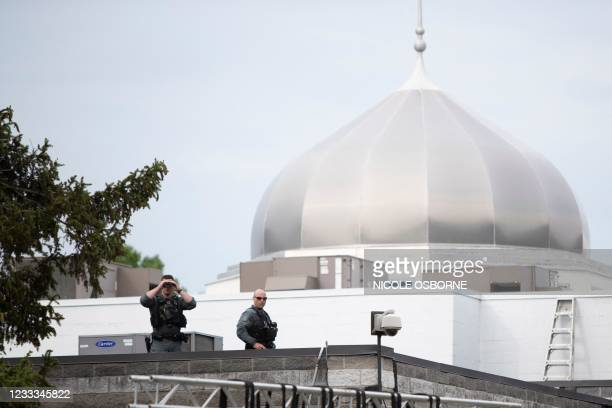 Police officers stand on the roof of the London Muslim Mosque during as Canada's Prime Minister Justin Trudeau attends vigil for the victims of the...