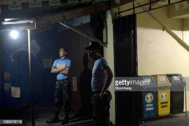 Police officers stand outside a makeshift disaster relief operations center ahead of Typhoon Mangkhut's arrival in Tuguegarao Cagayan province the...