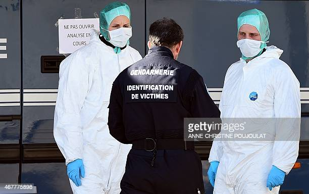 Police officers stand outside a mobile laboratory where the DNA samples of victims of the Germanwings air crash are being tested in SeynelesAlpes on...