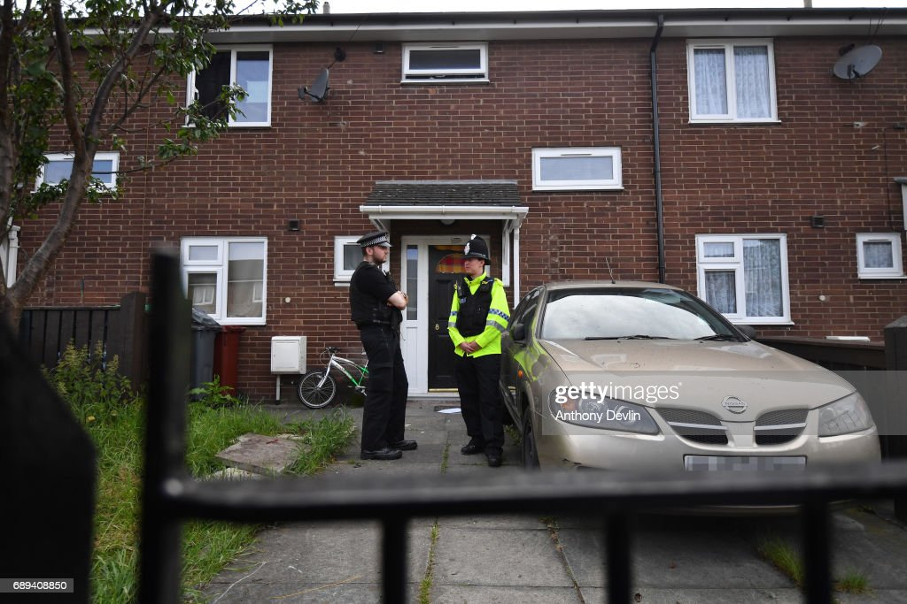 Police officers stand outside a property in Quantock Street in the Moss Side area of Manchester where a raid was carried out earlier on May 28, 2017 in Manchester, England. Security in the city remains high since the Manchester Arena suicide bombing which killed 22 people on the evening of May 22 as concert goers were leaving the venue after an Ariana Grande performance.