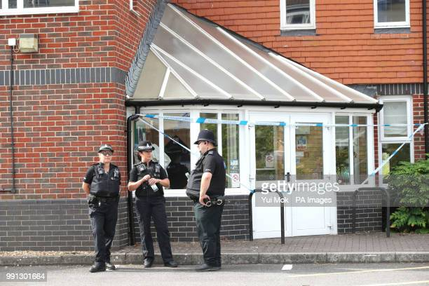 Police officers stand outside Amesbury Baptist Centre in Amesbury Wiltshire where a major incident has been declared after it was suspected that two...