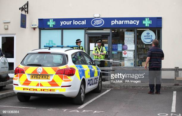 Police officers stand outside Boots pharmacy near to the Barcroft Medical Centre in Amesbury Wiltshire where a major incident has been declared after...