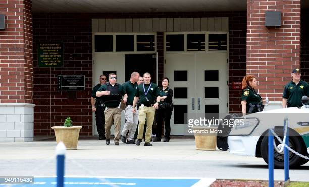Police officers stand outside Forest High School after a school shooting on April 20 2018 in Ocala Florida It was reported that a former student shot...