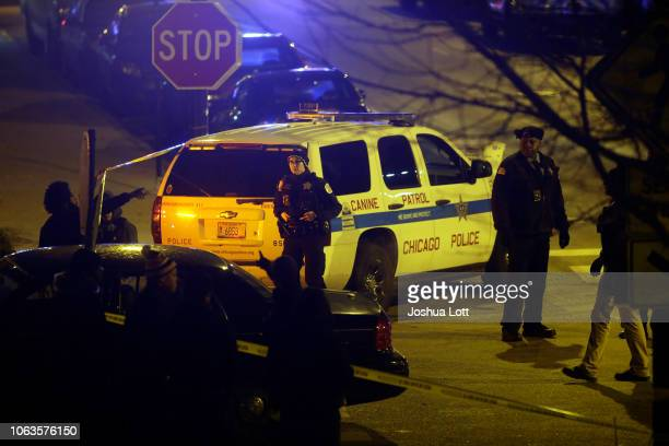 Police officers stand outside Mercy Hospital after a gunman shot multiple people on November 19, 2018 in Chicago, Illinois. Five people were shot...