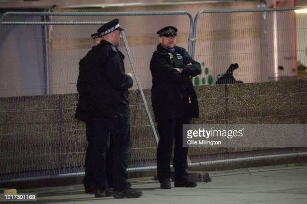 Police officers stand outside St Thomas Hospital in Westminster, where British Prime Minister Boris Johnson has now been transferred to the ICU after...