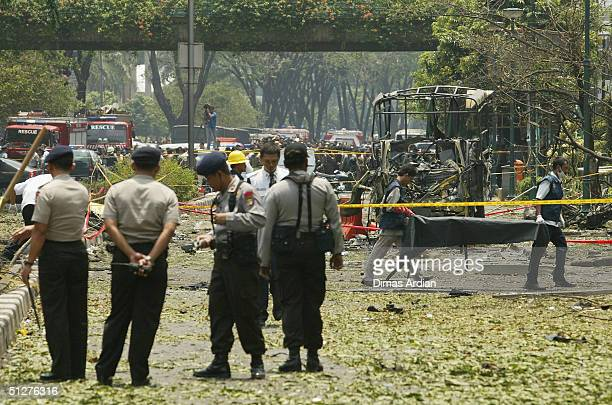 Police officers stand outside the Australian Embassy following a bomb blast Thursday Sept 9 in Jakarta Indonesia A powerful explosion in central...