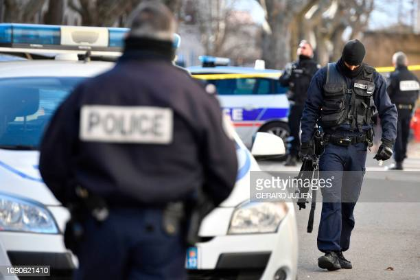 Police officers stand outside the Courthouse of Tarascon southeastern France on January 28 2019 after three armed persons attacked a penitentiary...