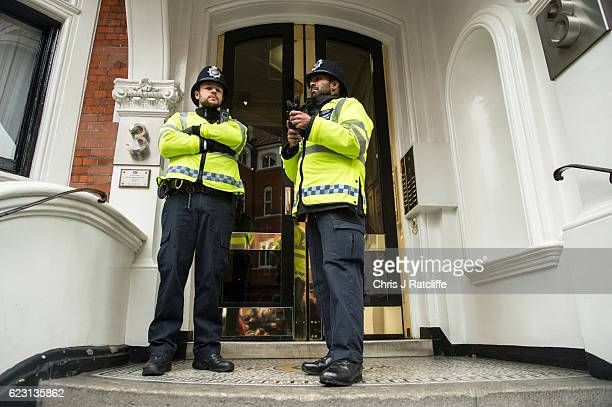 Police officers stand outside the Embassy of Ecuador as Swedish prosecutors question Wikileaks founder Julian Assange on November 14 2016 in London...