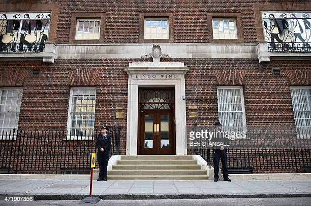 Police officers stand outside the entrance to the Lindo wing at St Mary's hospital in central London, on May 2, 2015 after the announcement was made...