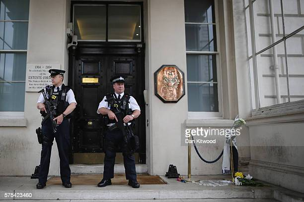 Police officers stand outside the French Embassy on July 15 2016 in London England At least 84 people have been killed after a lorry ploughed through...