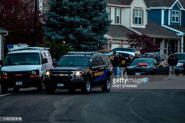 Police officers stand outside the home of one of the alleged gunmen behind the STEM School Highlands Ranch shooting in Highlands Ranch Colorado on...