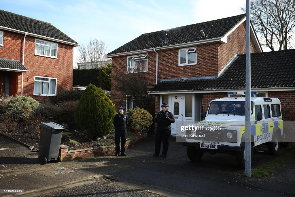 Police officers stand outside the home of Sergei Skripal after Sergei Skripal, 66 and his duaghter Yulia Skripal, in her 30s, were found unconscious in Salisbury town centre two days previously, on March 6, 2018 in Salisbury, England. Sergei Skripal who was granted refuge in the UK following a 'spy swap' between the US and Russia in 2010 and his daughter remain critically ill after being exposed to an 'unknown substance'.