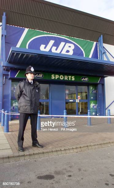Police officers stand outside the JJB Sports in Alpine Way Beckton east London Police have announced a 36yearold sports shop manager had a gun held...