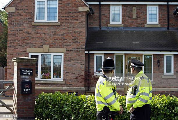 Police officers stand outside the McCann's house at the family home in Rothley Leicestershire in central England 10 September 2007 The parents of...