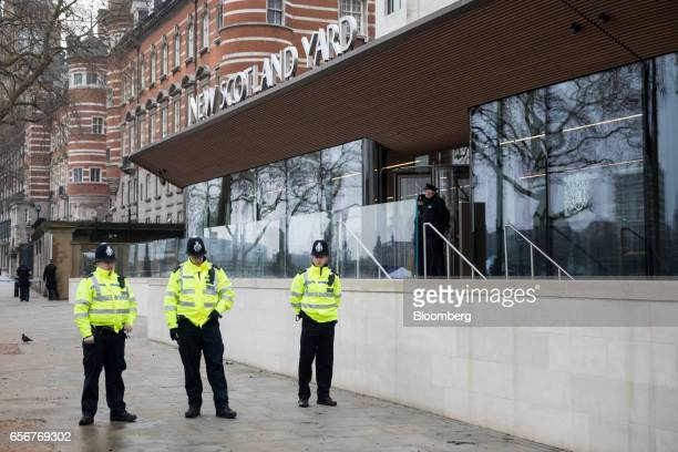 Police officers stand outside the New Scotland Yard headquarters of the Metropolitan police force in central London UK on Thursday March 23 2017...