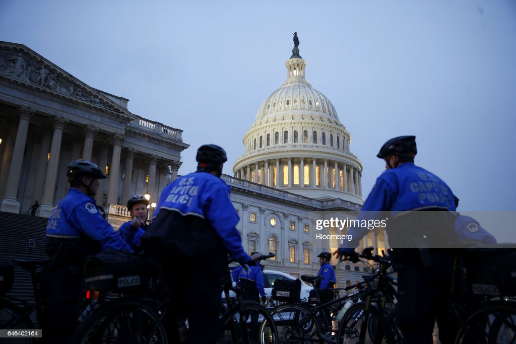 Police officers stand outside the U.S. Capitol building ahead of a joint session of Congress in Washington, D.C., U.S., on Tuesday, Feb. 28, 2017. President Donald Trump will press Congress to carry out his priorities for replacing Obamacare, jump-starting the economy and bolstering the nations defenses in an address eagerly awaited by lawmakers, investors and the public who want greater clarity on his policy agenda. Photographer: Andrew Harrer/Bloomberg via Getty Images