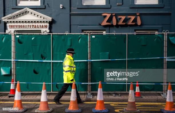 Police officers stand outside Zizzi restaurant as it remains closed as investigations continue into the poisoning of Sergei Skripal on March 11 2018...