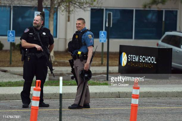 Police officers stand watch at the scene of a shooting in which at least seven students were injured at the STEM School Highlands Ranch on May 7 2019...