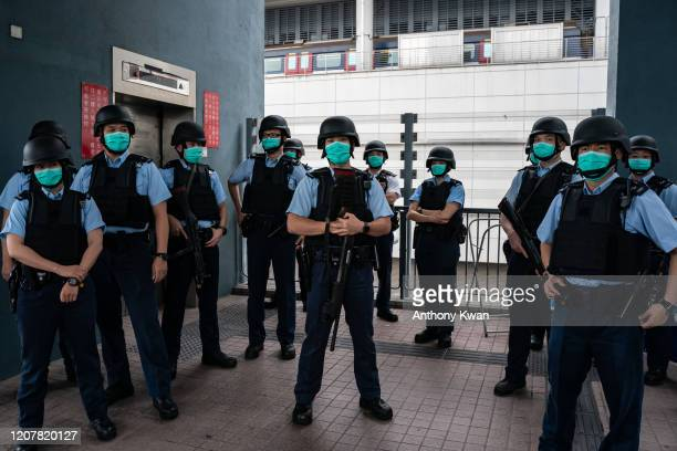 Police officers standby during an interdepartmental counterterrorism exercise codenamed CATCHMOUNT at Lok Ma Chau Spur Line Control Point in Hong...
