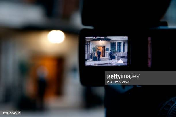 Police officers standing guard at the entrance to King Edward VII's Hospital are pictured in a camera viewfinder, in central London on March 5 where...