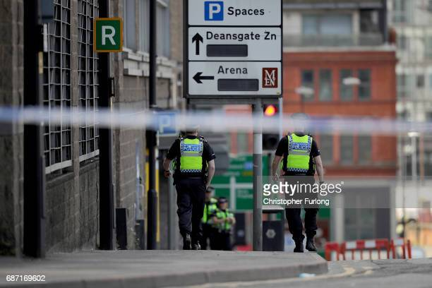 Police officers stands guard by Manchester Arena after last nights terrorist attack May 23 2017 in Manchester England An explosion occurred at...