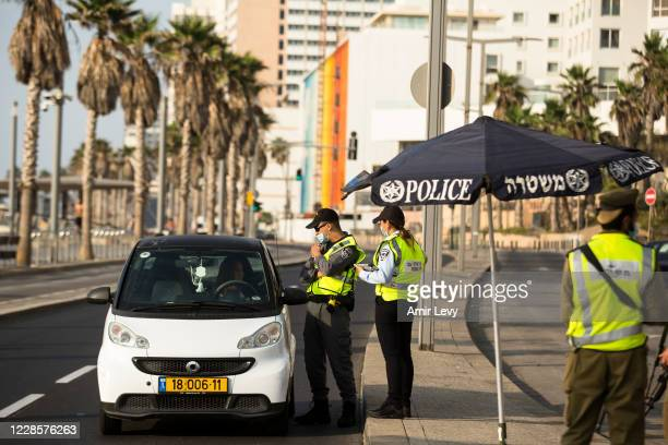 Police officers stop a car at a road block as Israel enters a new lockdown on September 18, 2020 in Tel Aviv, Israel. As the country grapples with a...